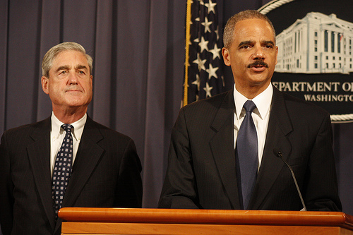 Attorney General Eric Holder (Right).