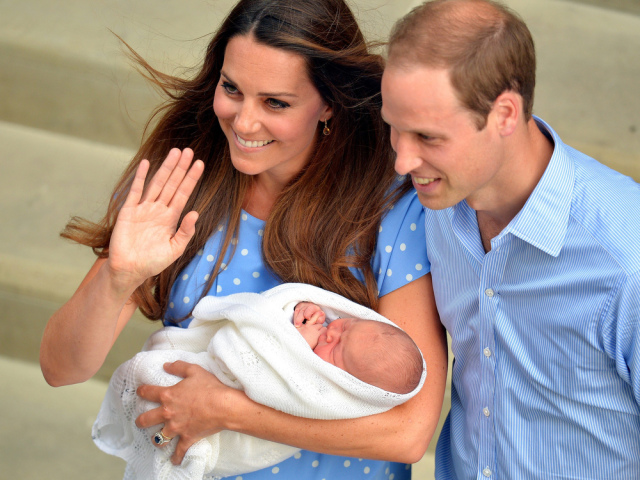 The royal couple with Prince George. Photo via  newsfeed.time.com