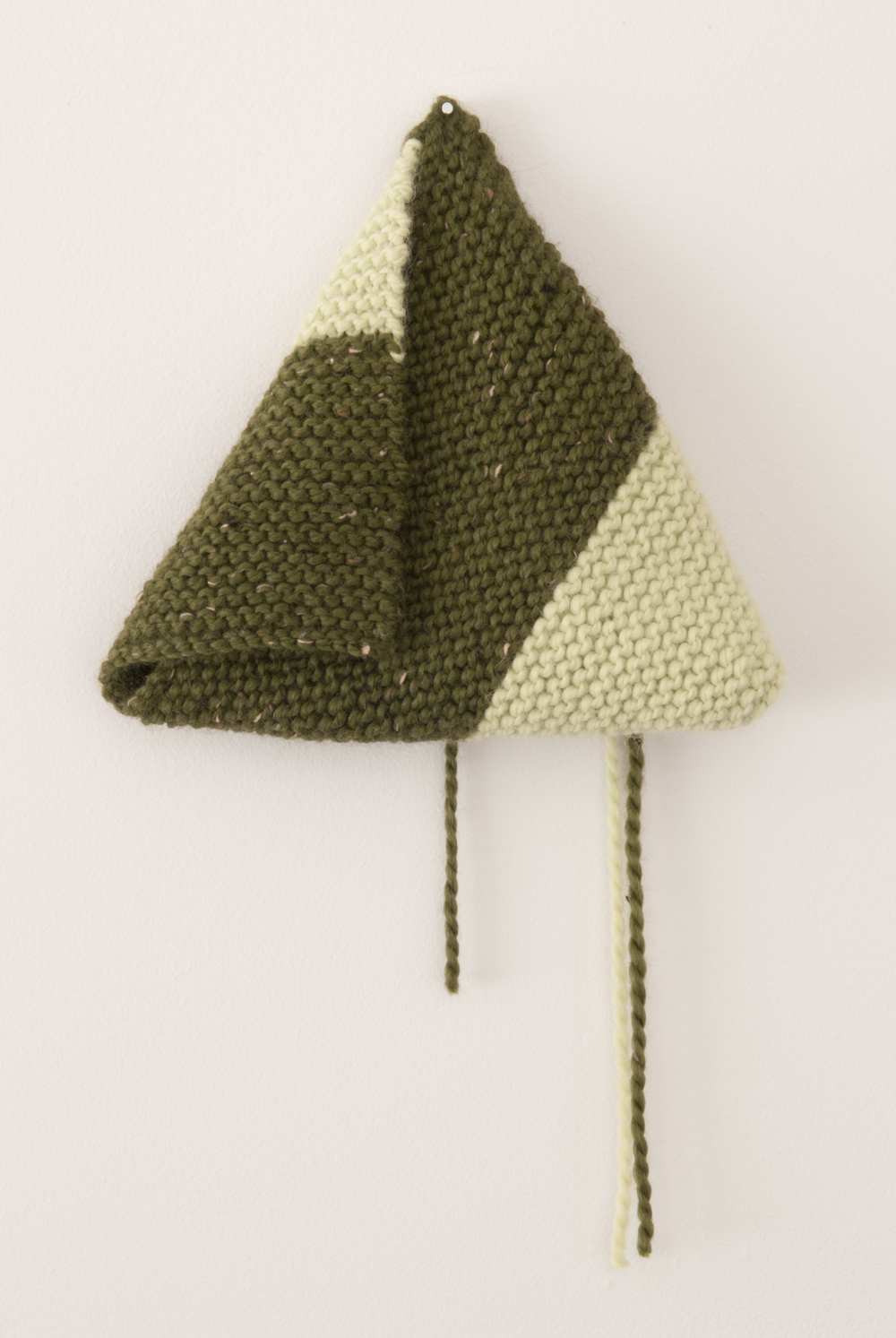 Ann Romano  | 2013  | hand knitted cotton and wool | 11 x 11