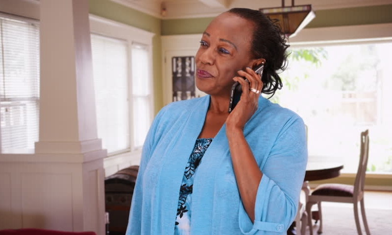 Woman Speaking Mobile Phone Call Modern Home.jpg
