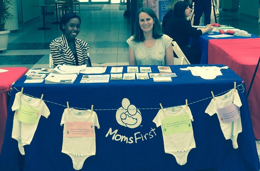 MomsFirst administration staff, Victoria Davis and Megan Walsh, staff the MomsFirst table at the World No Tobacco Day event.