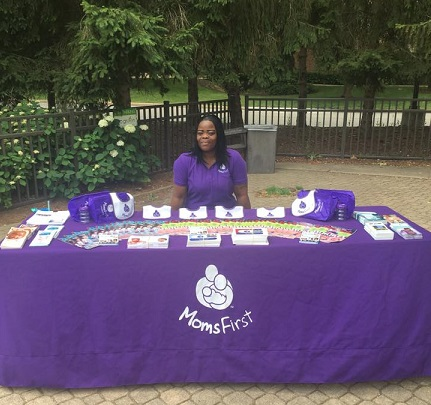 The MomsFirst table, staffed by Catherine Robinson, at Cleveland Metroparks Zoo.