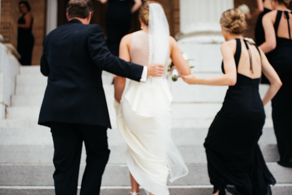 photograph of bride rushing up stairs