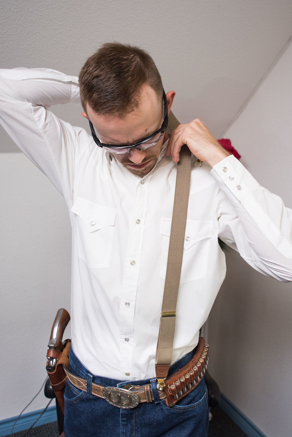 6 Groom putting on suspenders.jpg