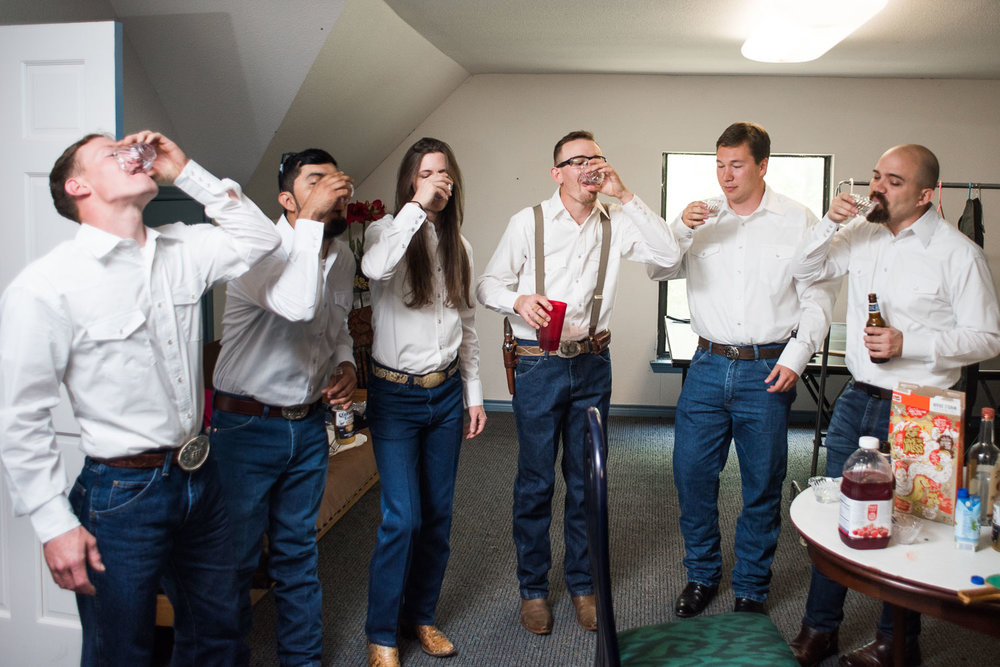 8 Groom and Groomsmen taking a tequila and reeces puff shot before photos.jpg