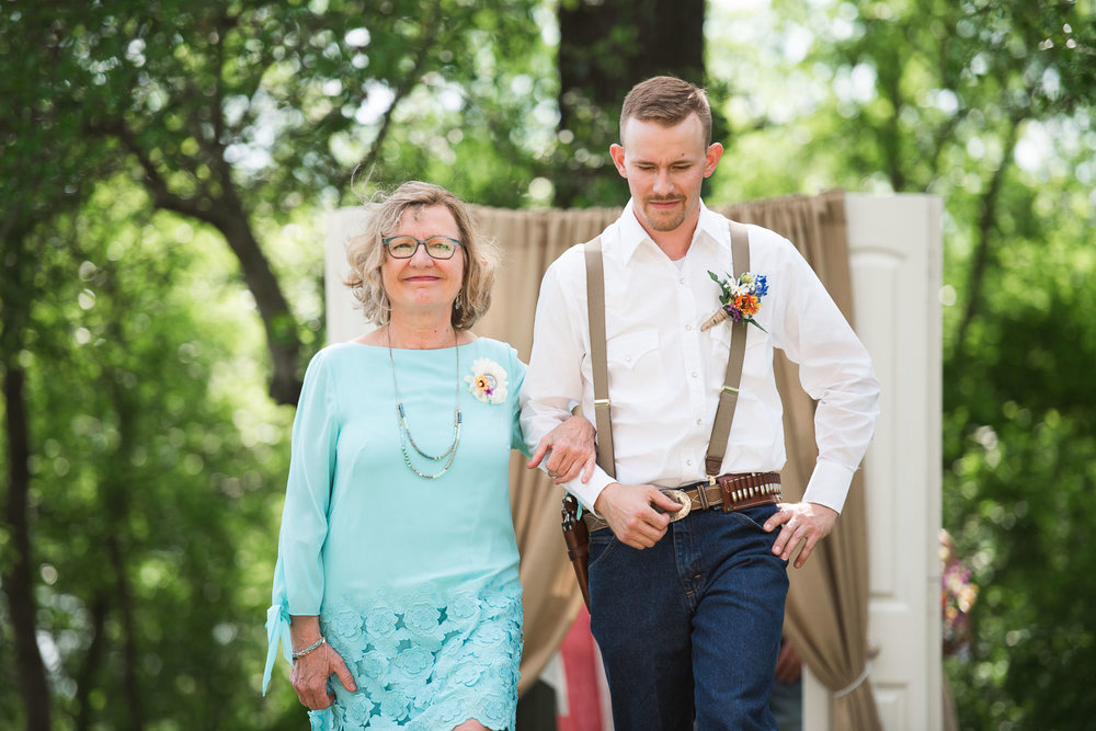 24 Groom walks his mother down the aisle.jpg