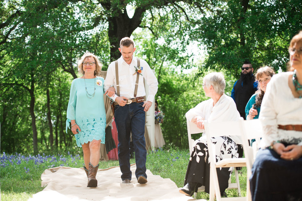 25 Groom walks his mother down the aisle as guests look on.jpg