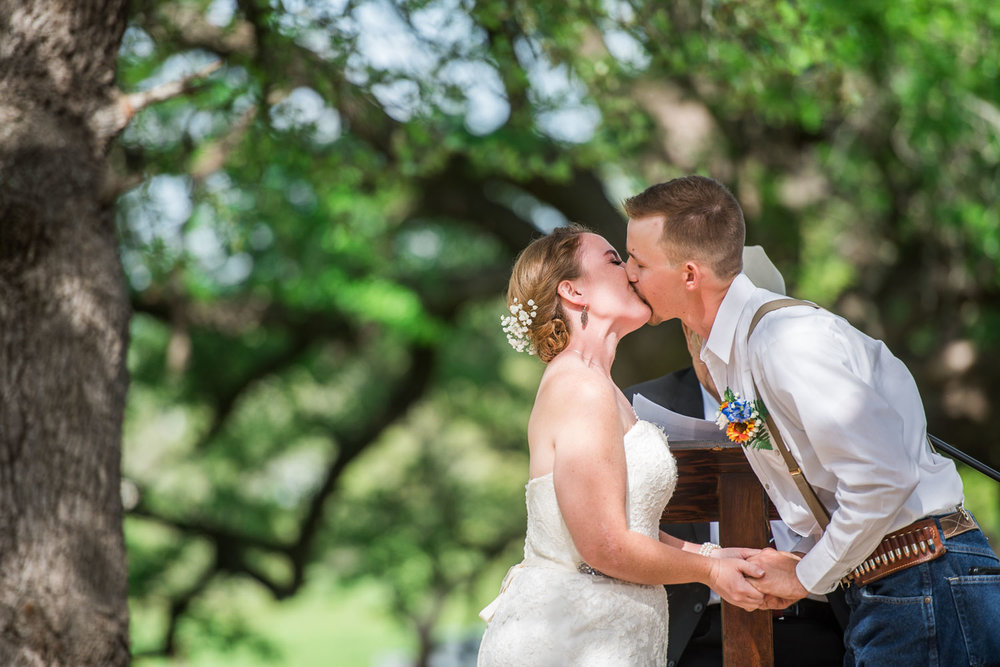 54 Bride and grooms first kiss.jpg