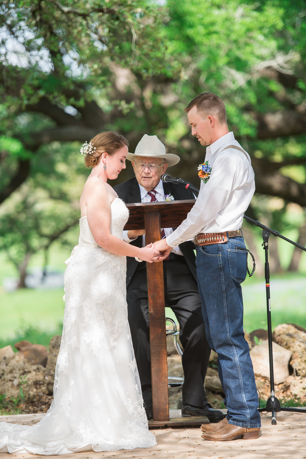 53 Bride and groom praying together at texas wedding.jpg