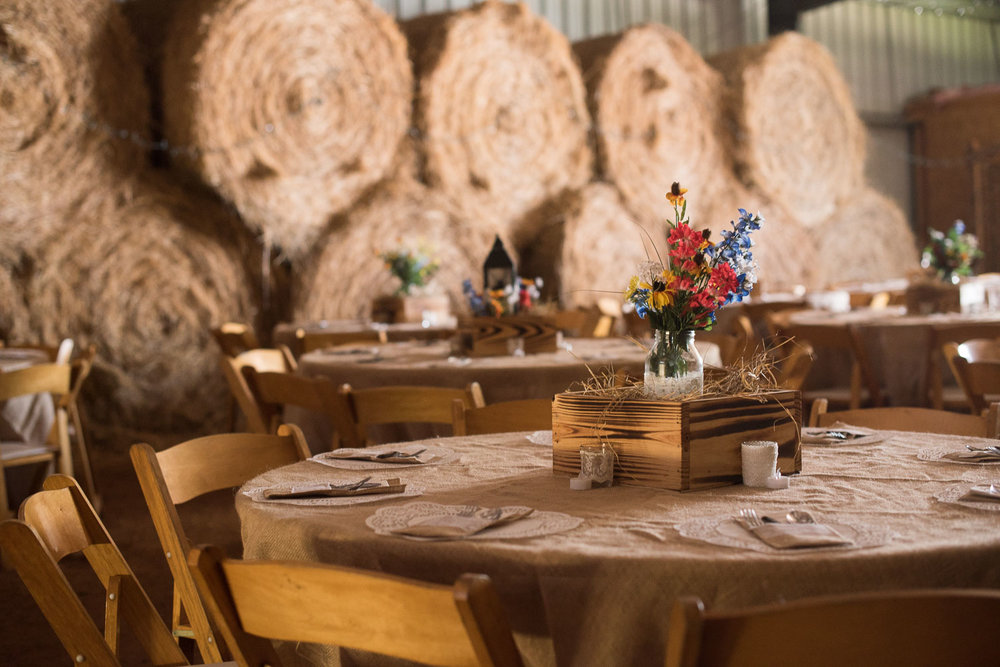 63 wedding reception in barn with hay bales.jpg
