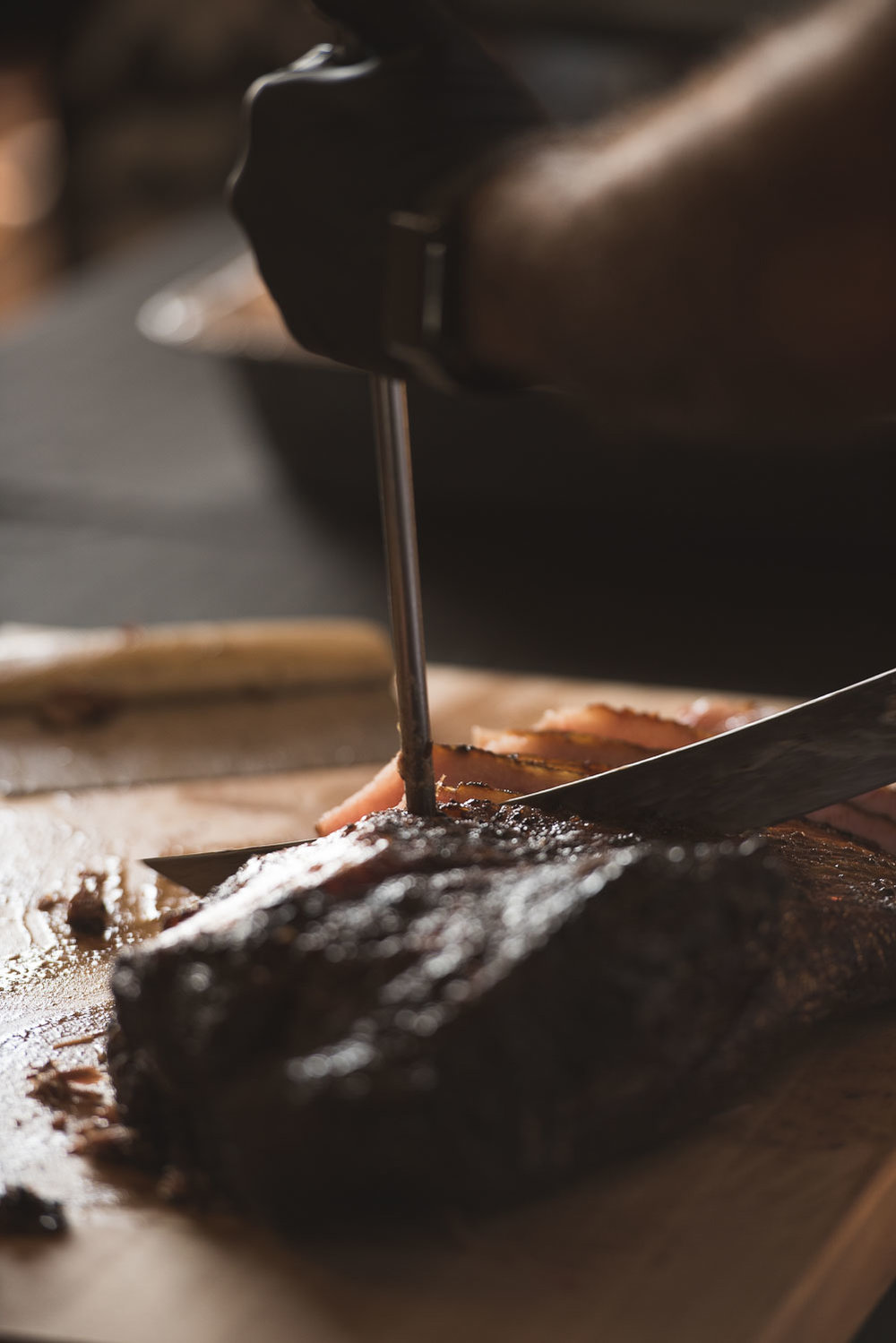 68 caterer cutting brisket from Kreuz barbecue.jpg