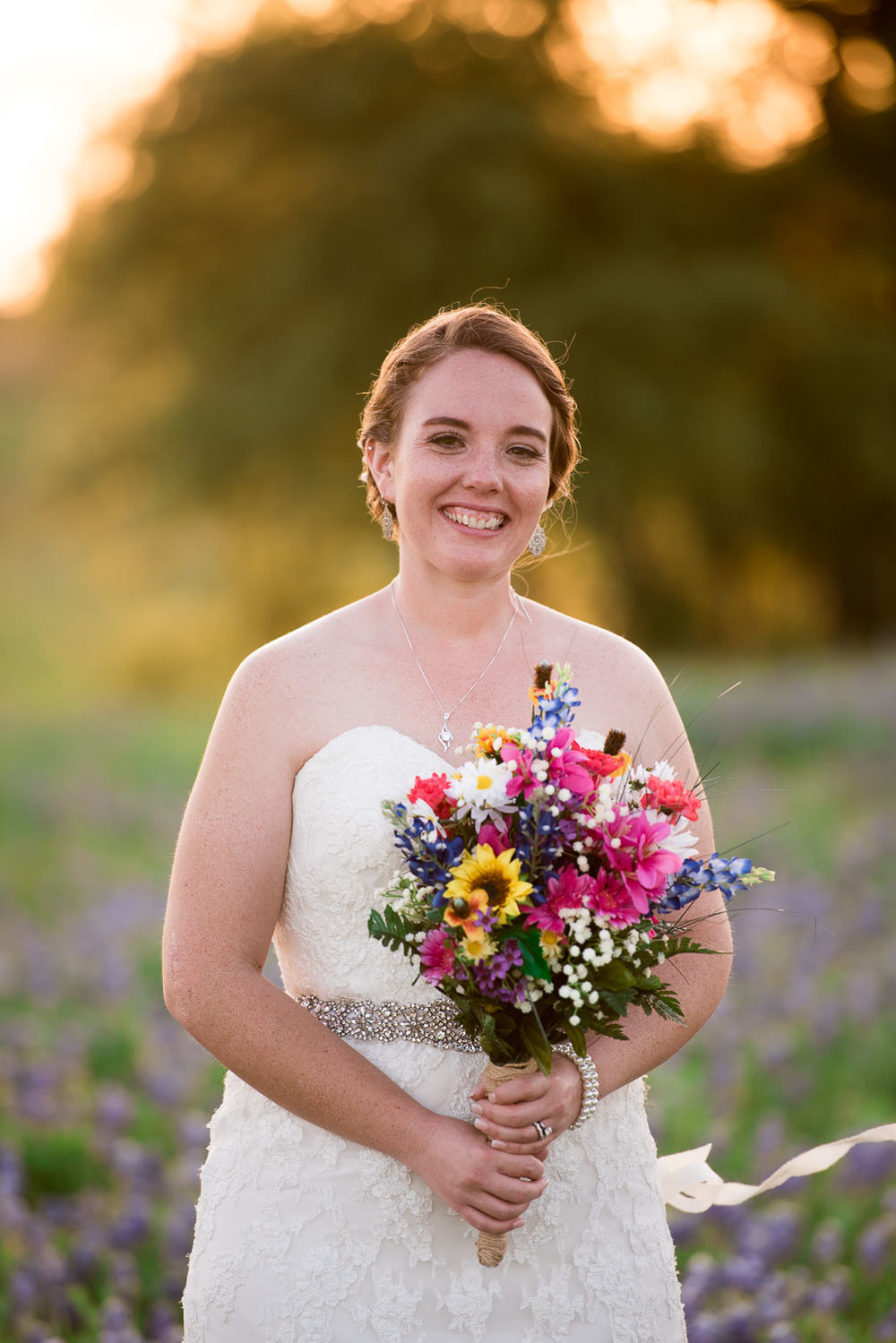 86 bridal detail with bouquet in texas farmland.jpg