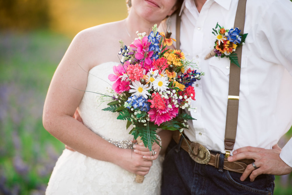 93 close up of bride and groom with floral.jpg