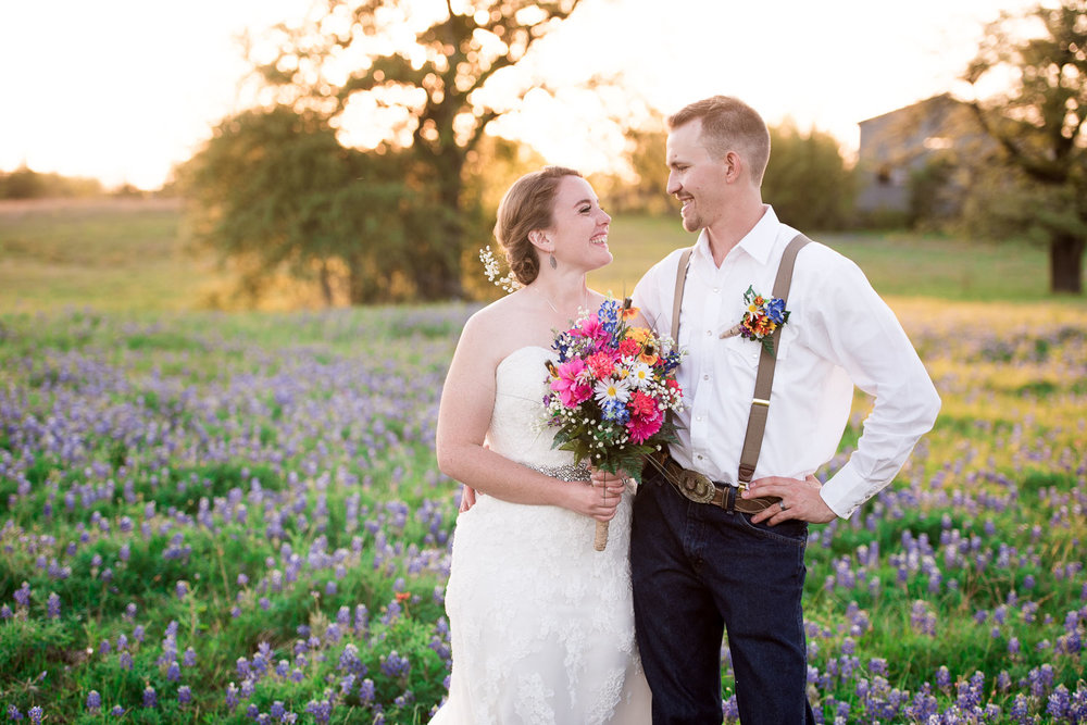 92 bride and groom together in a field of bluebonnets.jpg