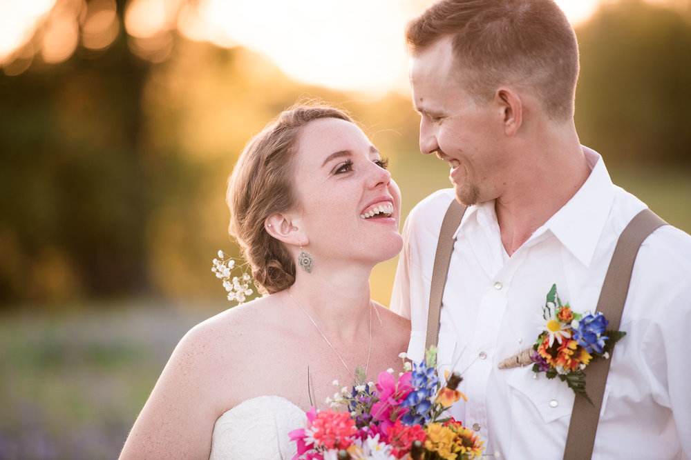 94 bride and groom at sunset in texas field.jpg