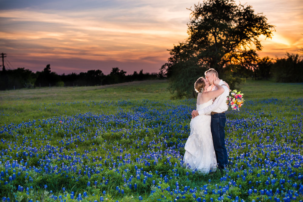 101 brittney and alexander watson wedding on family ranch in luling texas in bluebonnet field.jpg