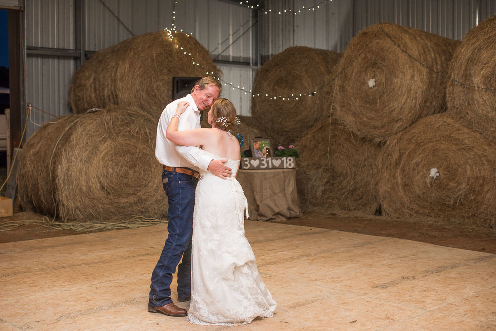 108 first dance at wedding at farm with hay bales.jpg