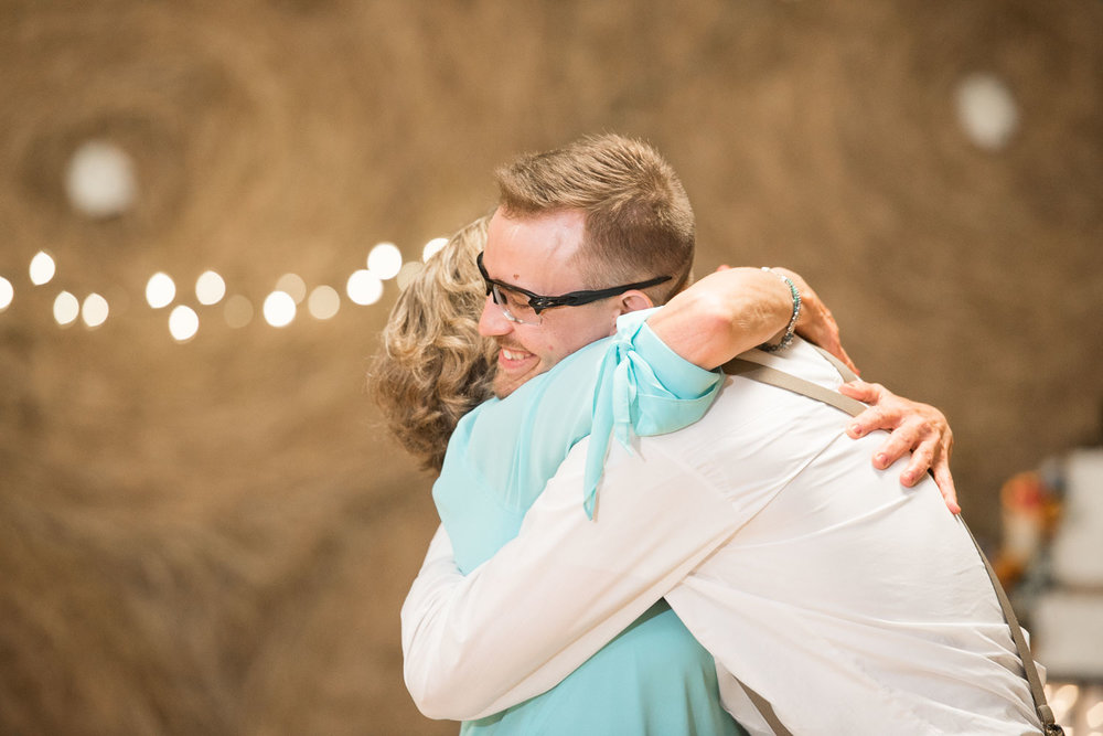 113 groom and mother of groom hug after first dance.jpg