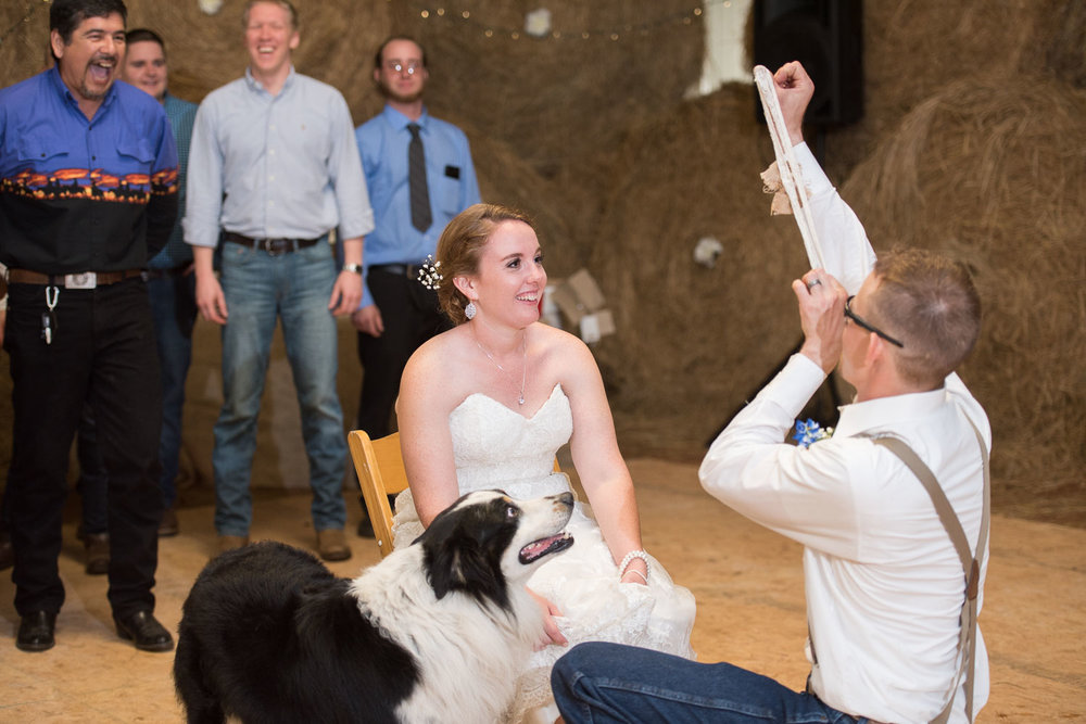 124 groom throws the garter.jpg