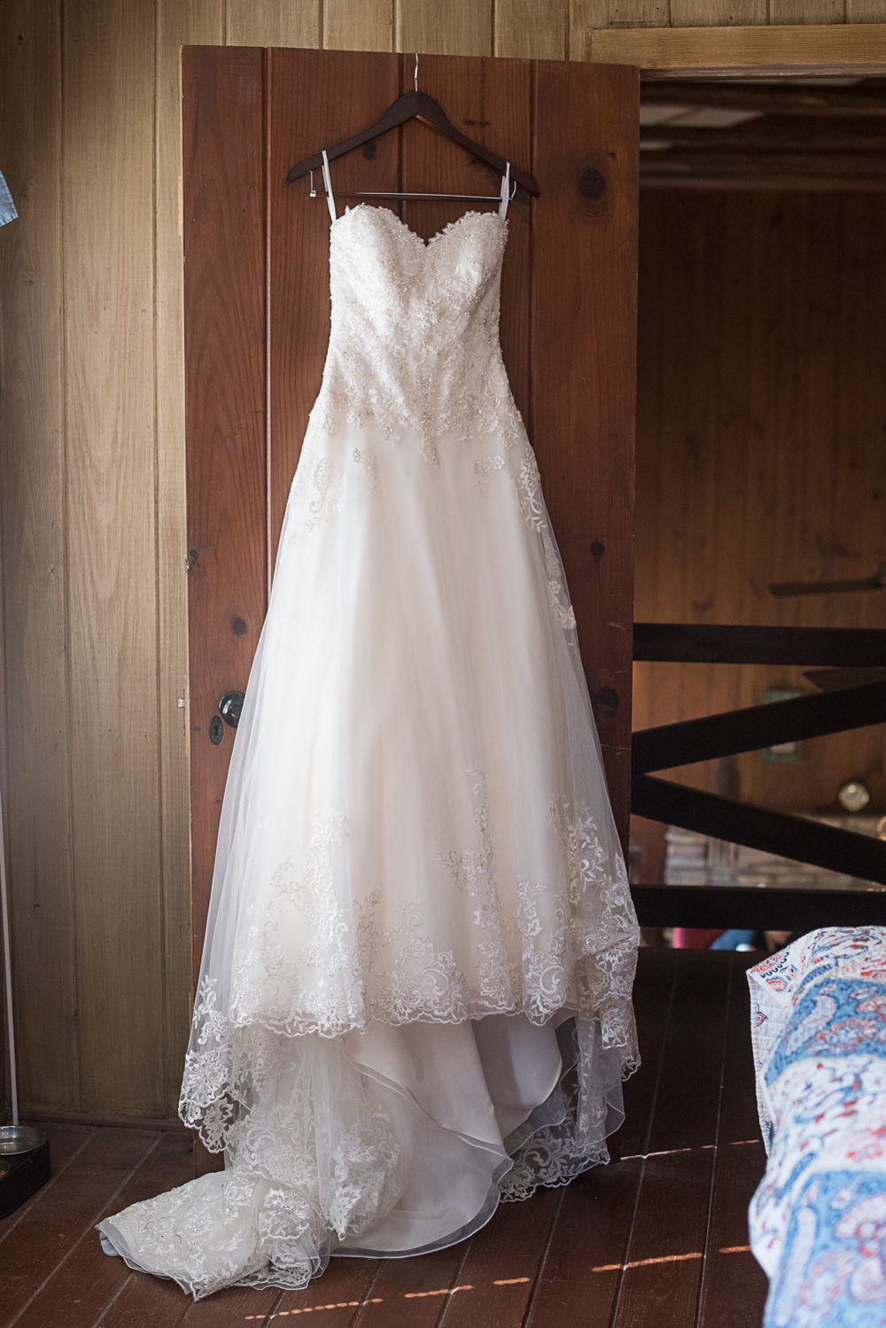 1 Wedding dress Hanging in doorway of family cabin.jpg