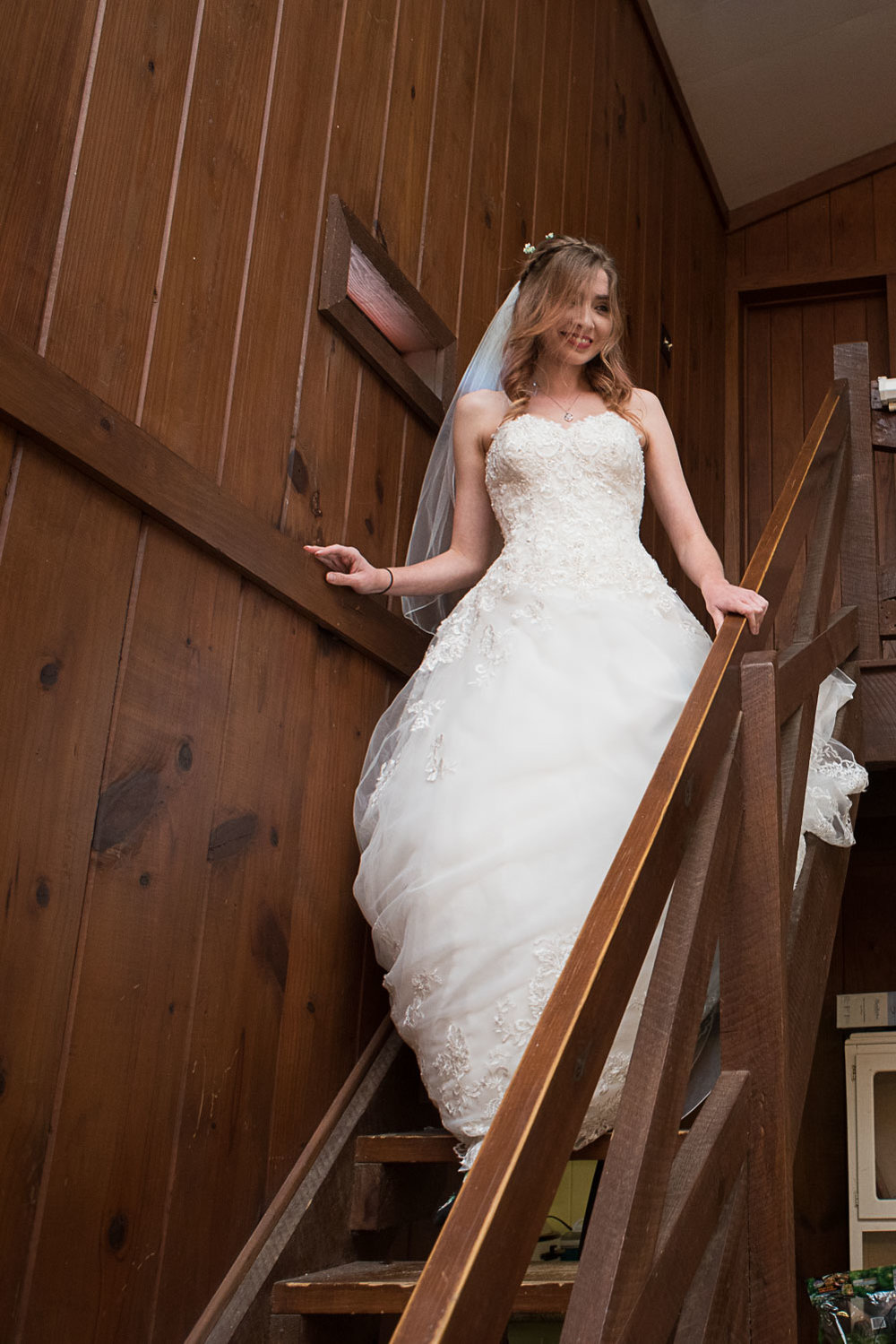 36 bride walking downstairs in family cabin in la grange.jpg