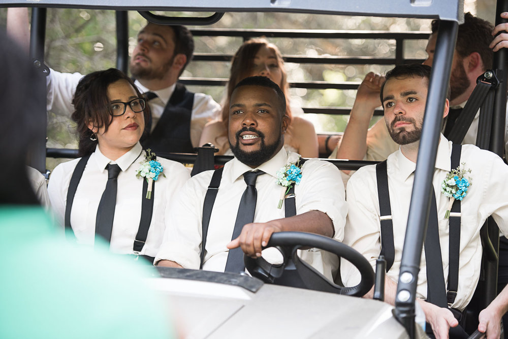 82 bridal party on golf cart.jpg