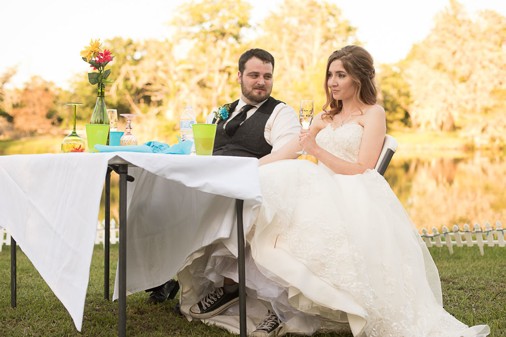 140 bride and groom with lake background.jpg