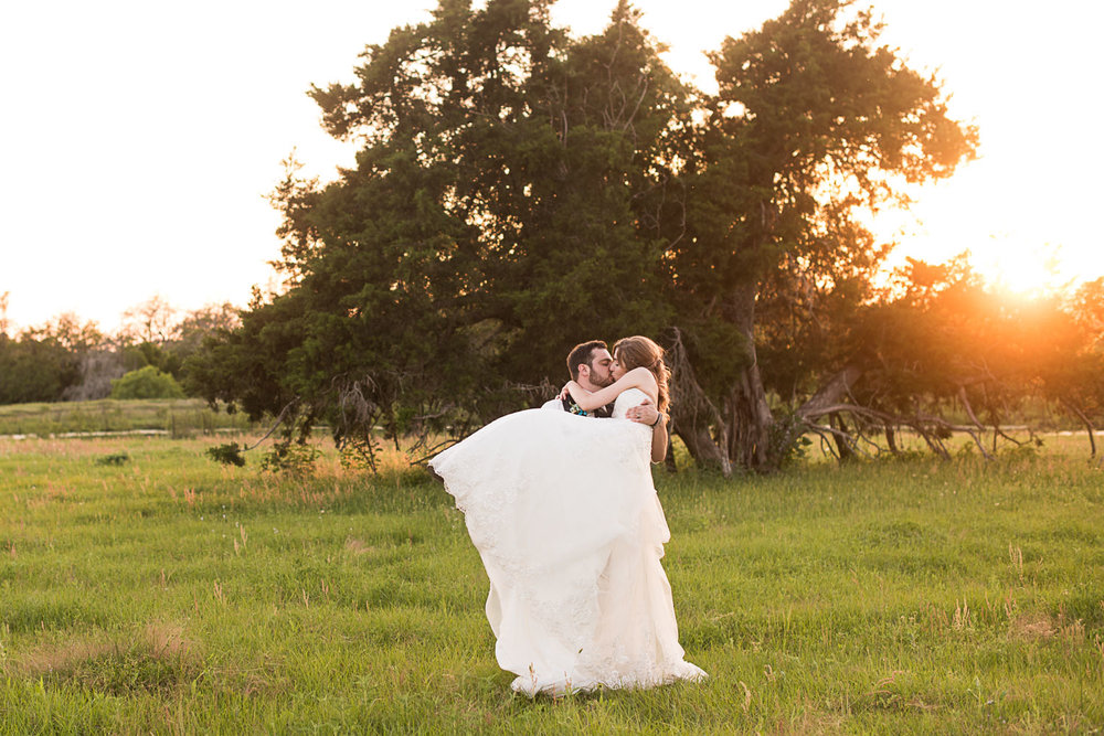 171 bride and groom during golden hour in a field.jpg