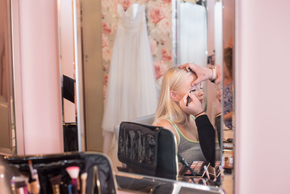 7. bride getting ready in mission theater suite.jpg