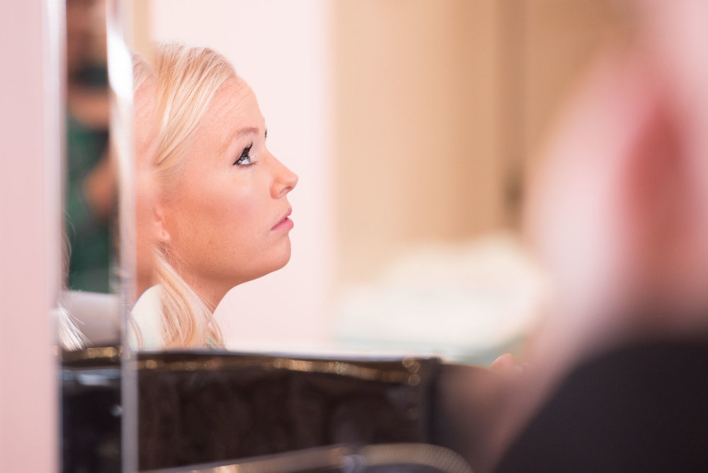 8. bride getting makeup done on wedding day.jpg