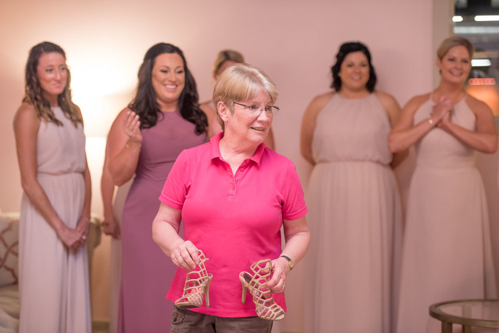 27 mother and bridesmaids helping bride get ready.jpg