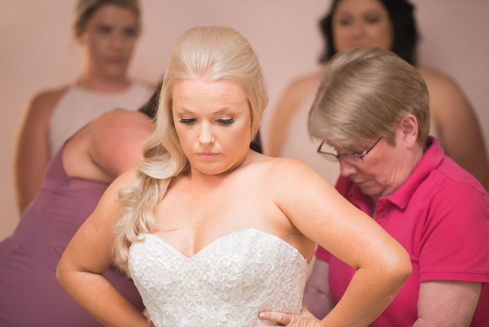 26 mother helping  bride get ready.jpg