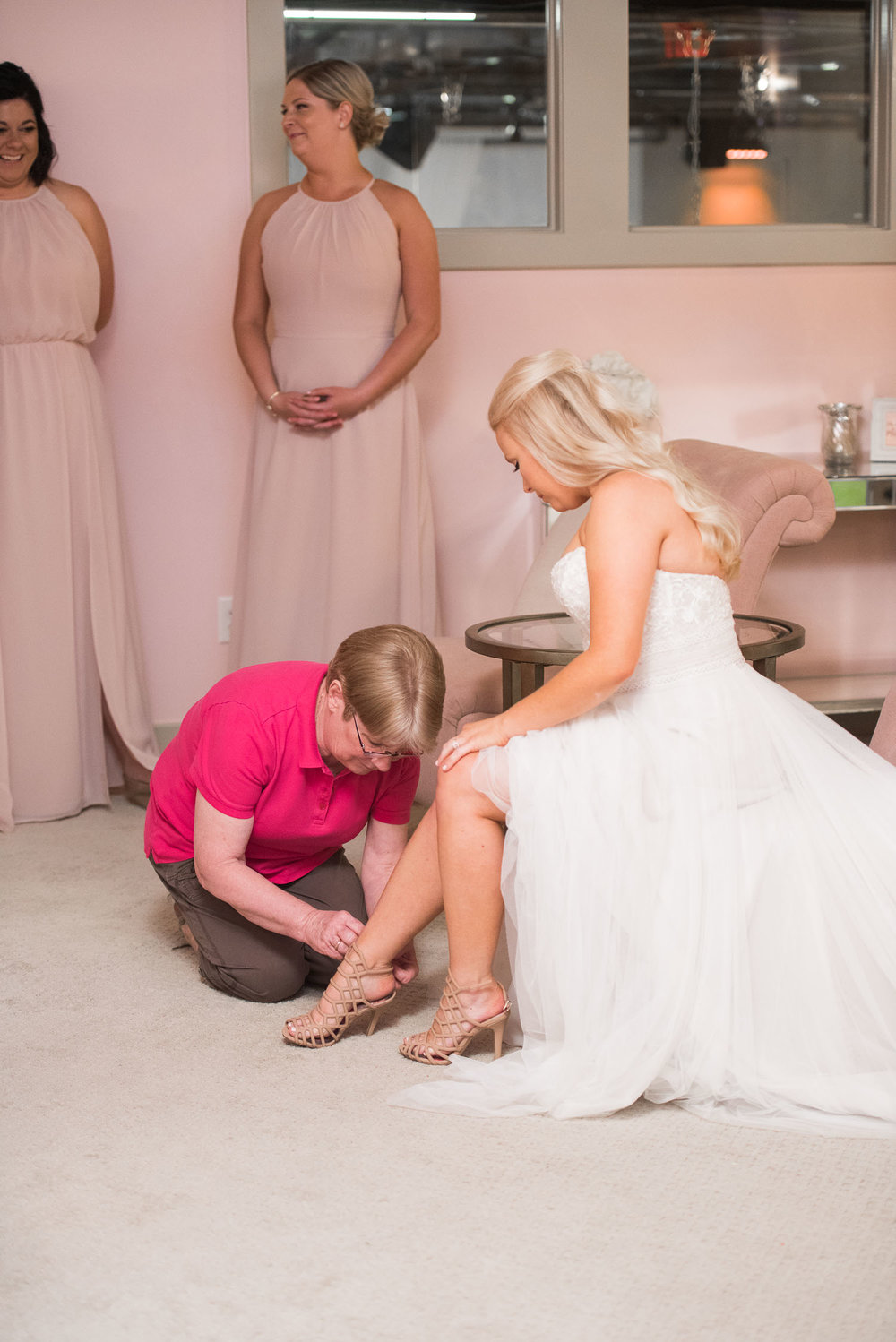 32 bride and mother putting on summer wedding shoes.jpg