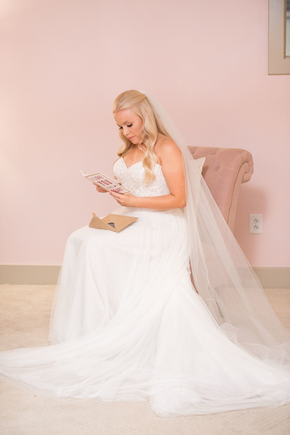 38 bride reads letter from her future husband.jpg