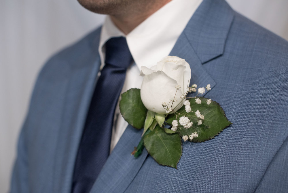 85 white rose boutonniere.jpg