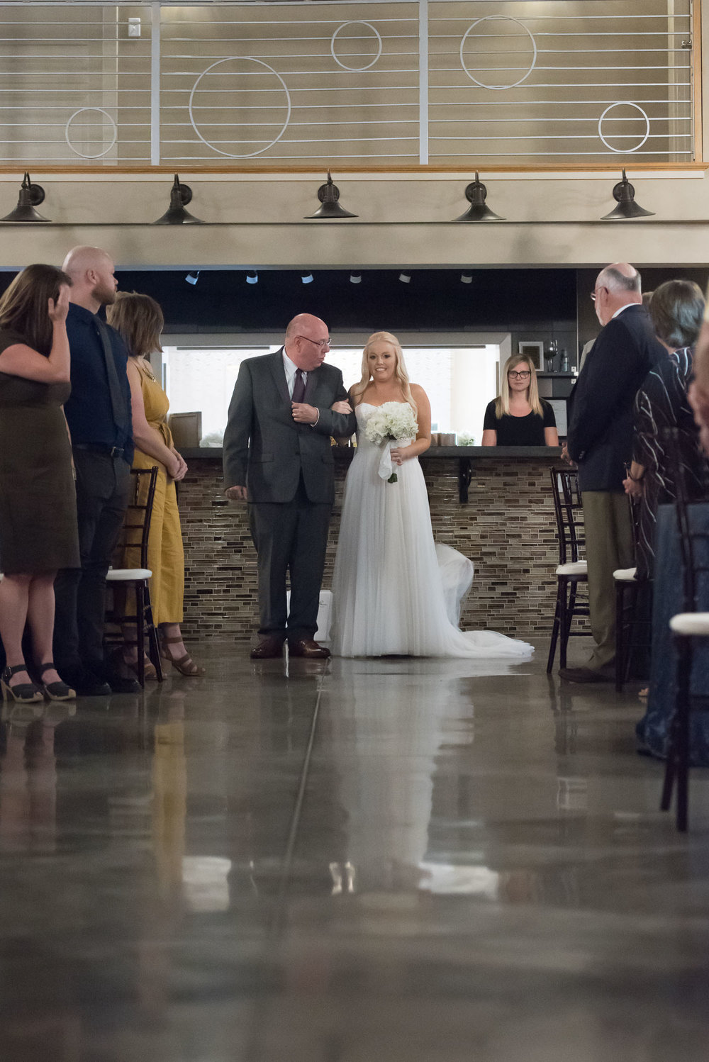 88 bride and father walk down the aisle at mission theater.jpg
