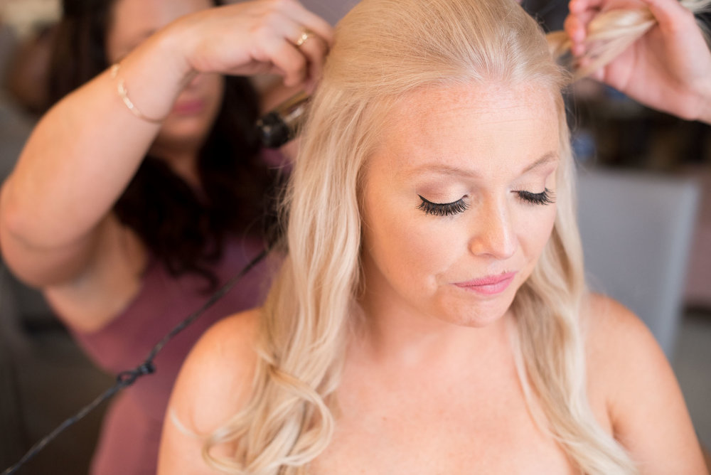 105 bride getting her hair done before wedding.jpg