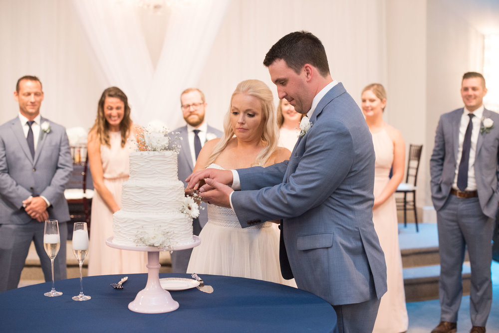 125 Bride and Groom Cutting Cake.jpg