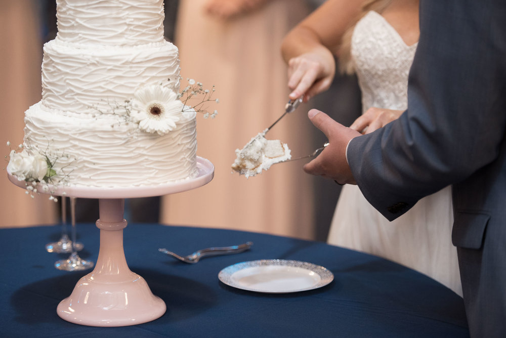 126 Bride and groom sharing slice of cake.jpg