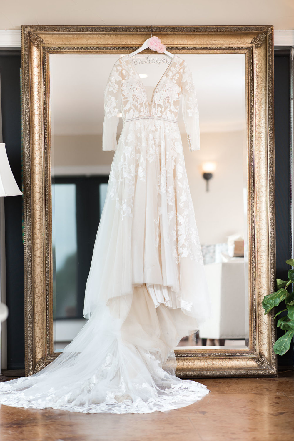 1 Wedding Dress hanging on vintage mirror.jpg