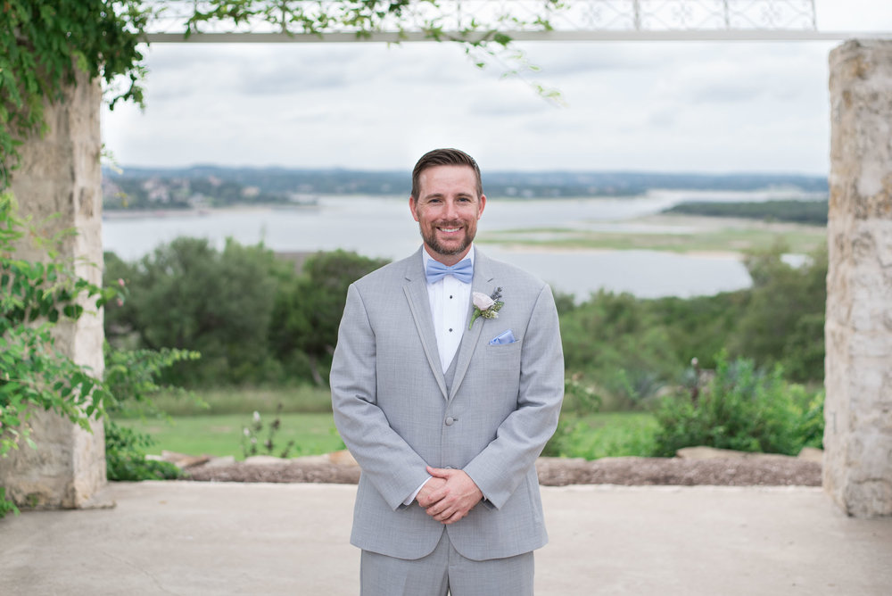 18 groom portraits at vintage villas over lake travis.jpg