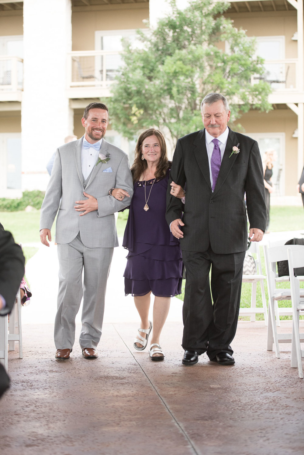 54 groom walking parents down aisle at vintage villas.jpg