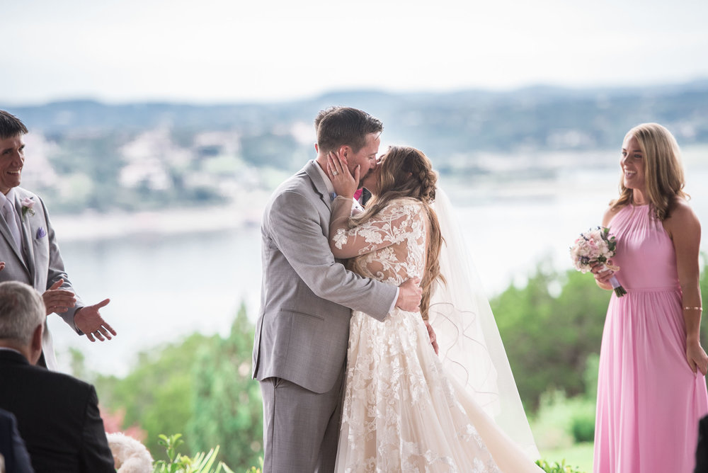 82 first wedding day kiss at lake travis.jpg