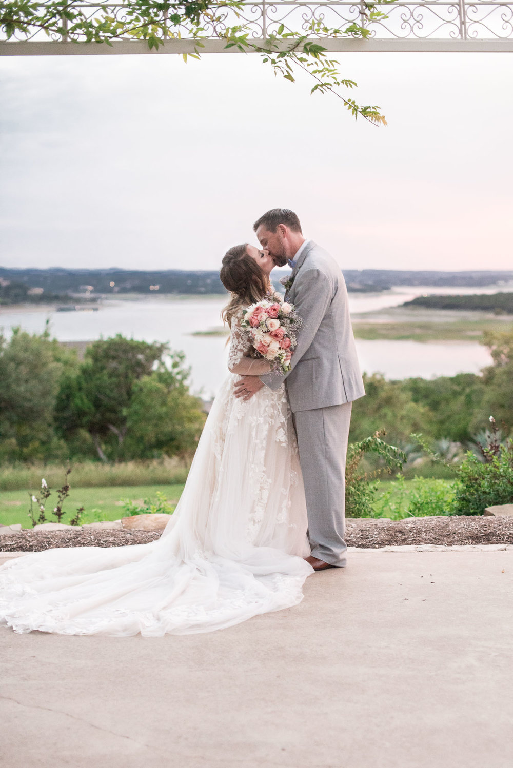 101 bride and groom overlooking lake travis.jpg