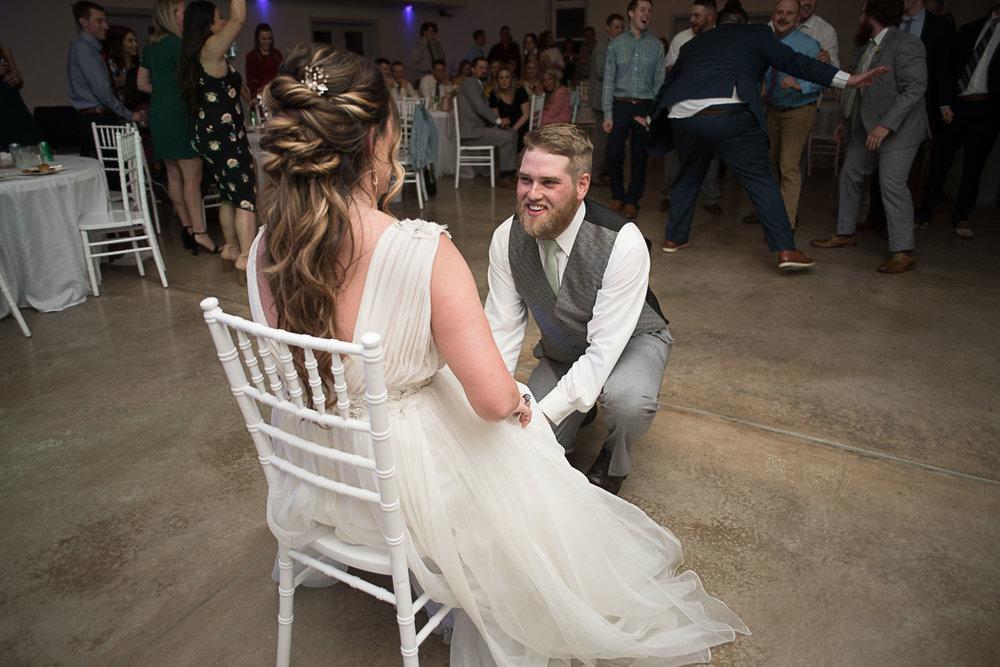 143 garter toss kansas city wedding.jpg