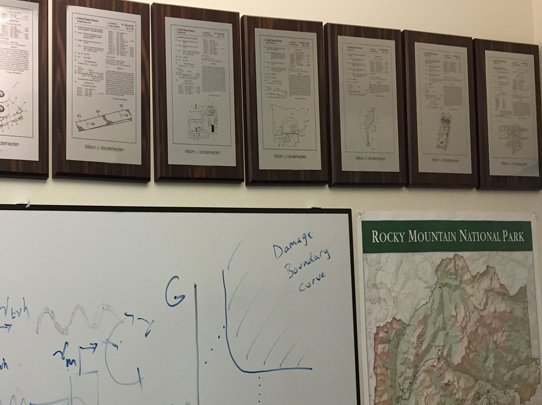 Patent plaques, whiteboard calculations, and plans for the next adventure.