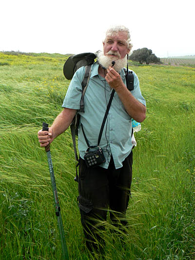 Dany Gaspar speaks to a group of hikers in the rolling green hills of the Galilee.