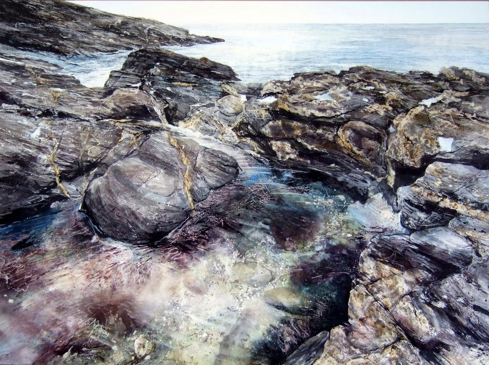 "Littoral Drift - watercolour - image 80 x 110cm Prussia Cove in South West Cornwall is accessible by foot from the coast path. It consists of four tiny bays connected by rocky outcrops. The area is steeped in history and folklore, named after the 18th century ship wrecker and smuggler John Carter (born 1738), also known as the 'King of Prussia'. Standing at the rocky edge you can be surrounded on three sides by the sea, giving a sense of the swell gliding by. The littoral zone extends from the high water mark to shoreline areas that are permanently submerged. The natural movement of the littoral along the coast is called the littoral drift. ""Between the salt water and the sea's strand"" – Anon"