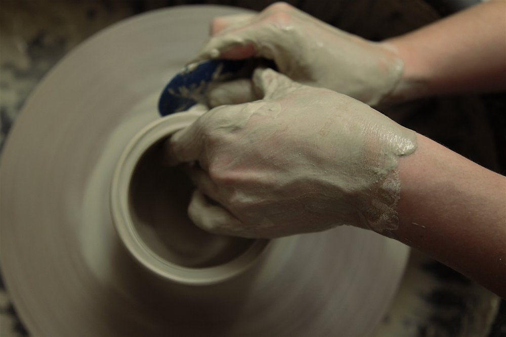Learning to throw on the potters wheel