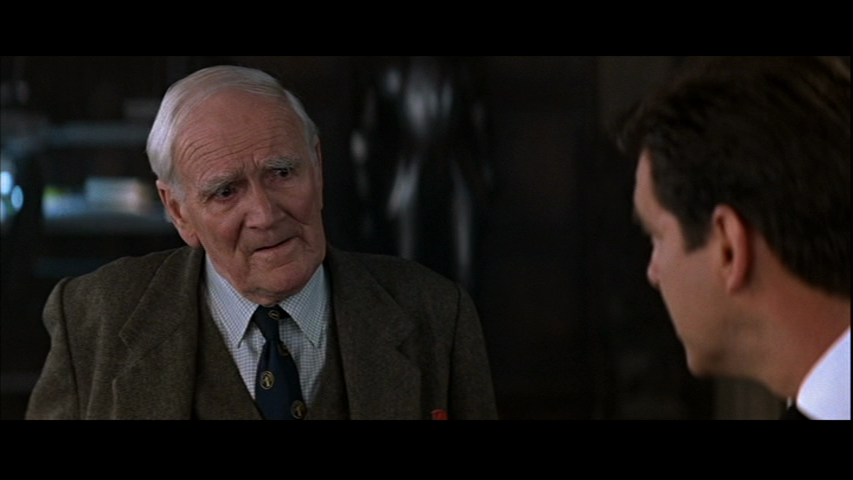 The-World-Is-Not-Enough-Q-James-Bond-Desmond-Llewelyn-Pierce-Brosnan.png